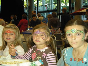 Children with faces painted, photo